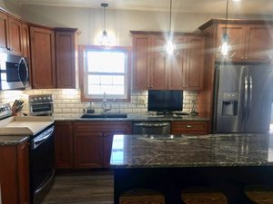 Maple-Cabinets-and-Cambria-with_Subway-Tile